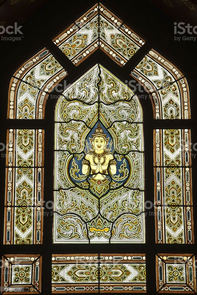 Antique Thai temple stained glass motif ,Bangkok Thailand. royalty-free stock photo
