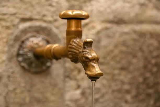 antique the water tap, italy - la spezia foto e immagini stock