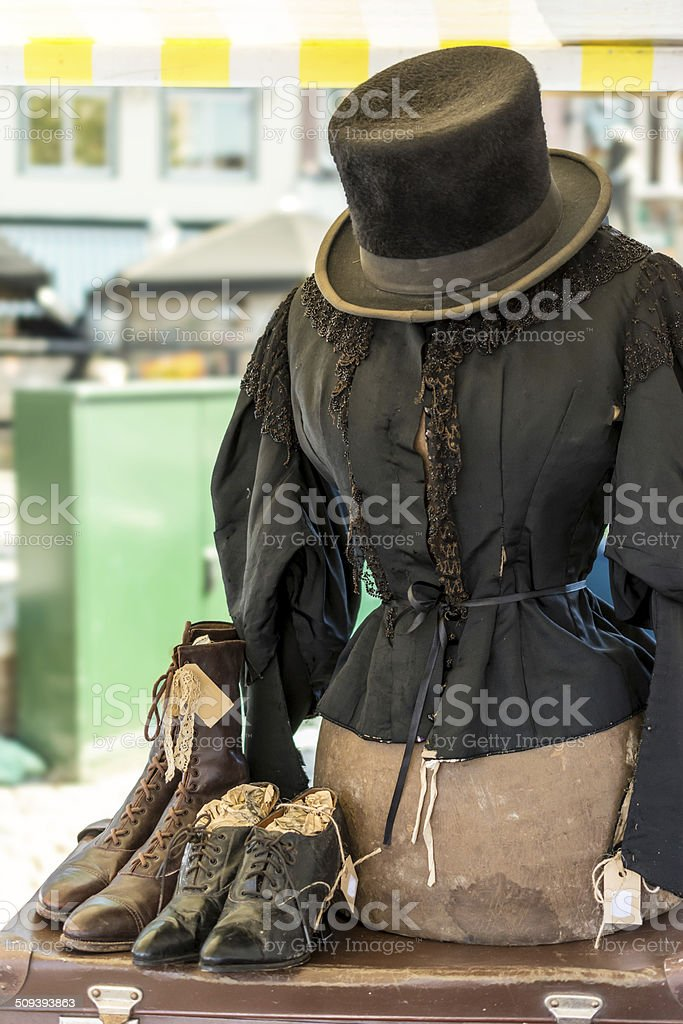 Antique top hat blouse and boots stock photo