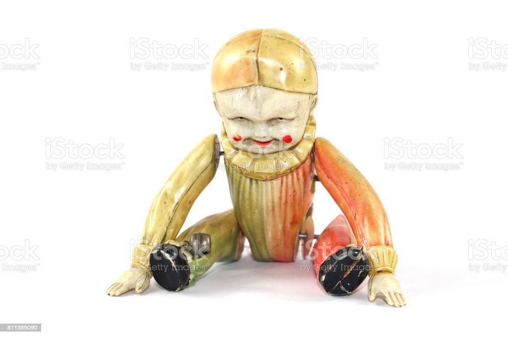 Antique Toy Clown Doll on Black Background stock photo
