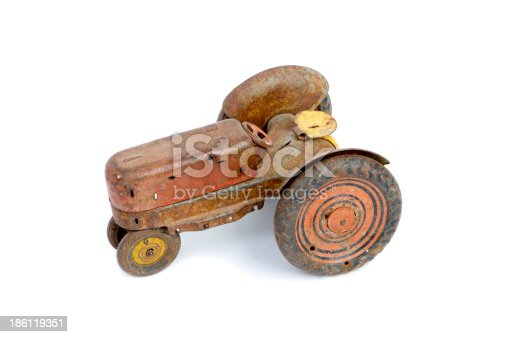 Isolate shot of an antique toy tractor.