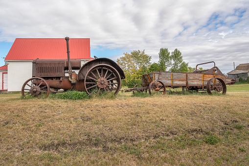Antique tractor and manure spreader in the village of Rowley, Alberta, Canada
