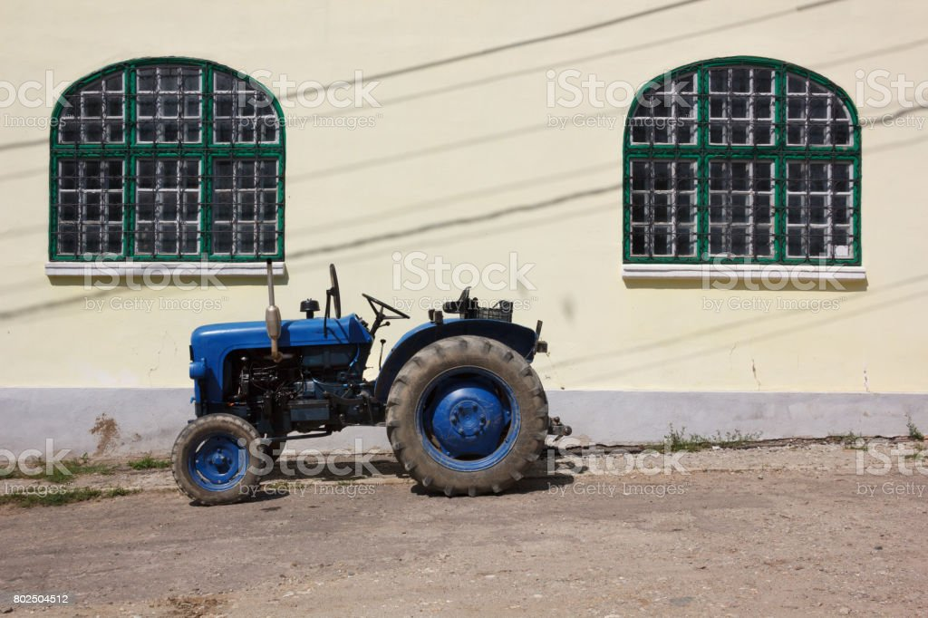 Antique tractor in a Romanian village stock photo