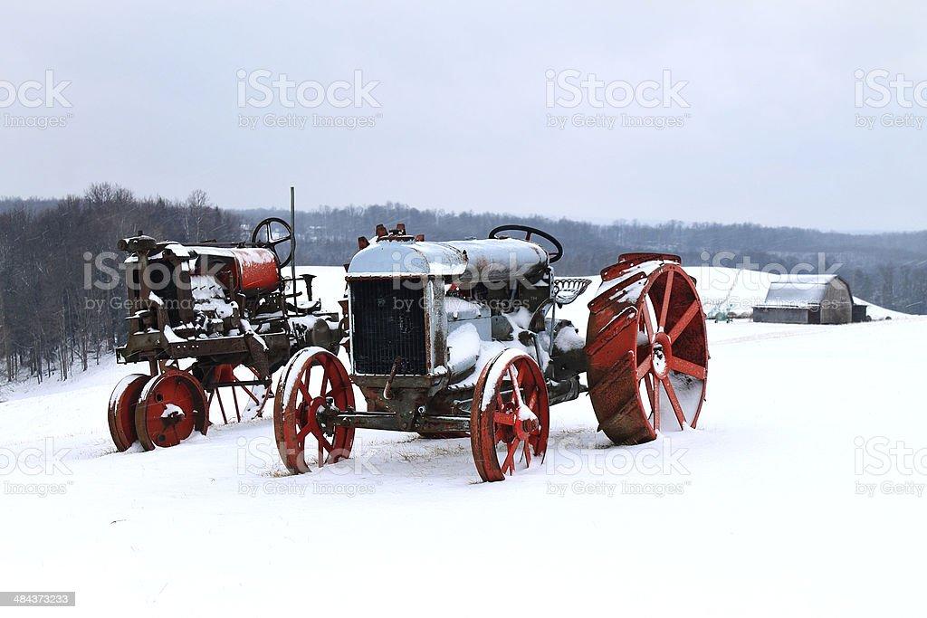 Antique Tractors - Snow - Stock Image stock photo