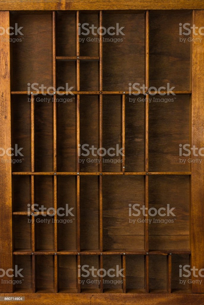 Antique Typesetter Drawer with Dividers Close Up Top View stock photo
