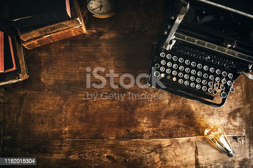 Top View. Typewriter and books on table