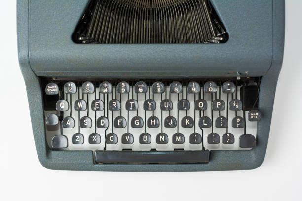 Antique Typewriter on White Background Close Up on Keys stock photo