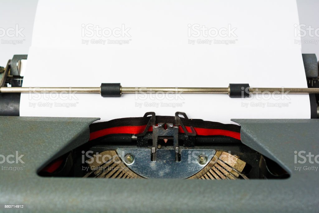 Antique Typewriter on White Background with Paper Close Up stock photo