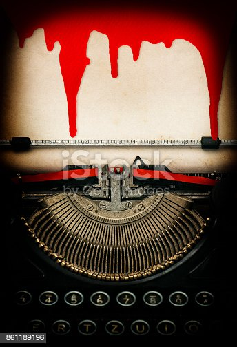 istock Antique typewriter paper sheet with blood Halloween concept 861189196