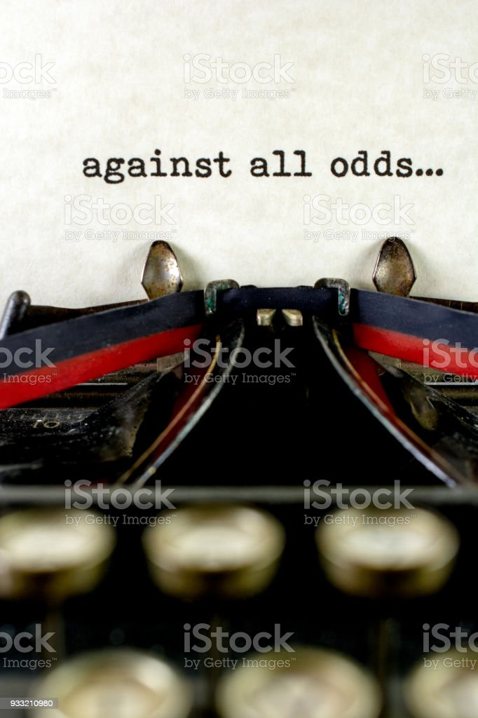 Antique typewriter with saying against all odds stock photo