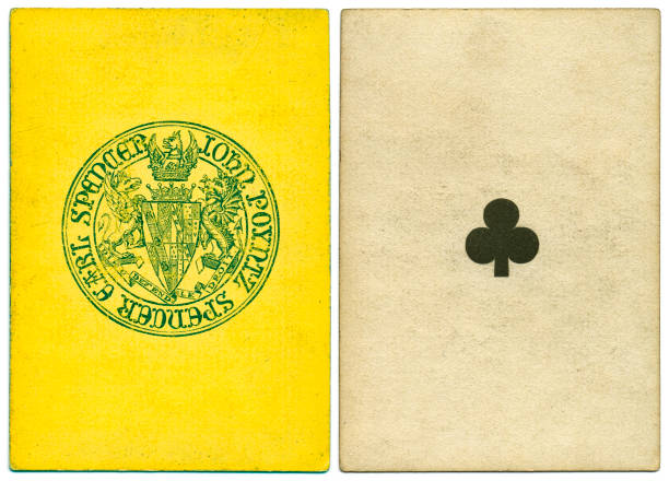 Antique Victorian 19th century playing card front and Earl Spencer back design Antique 19th century playing card with a yellow and green symbol back pattern that features the coat of arms of John Poyntz Spencer, the 5th Earl Spencer (born 1835). Motto in French: Dieu defend le droit. This card is an ace of clubs, featuring a crude club symbols The card has no indices (no numbers) at top and bottom. whiteway stock pictures, royalty-free photos & images