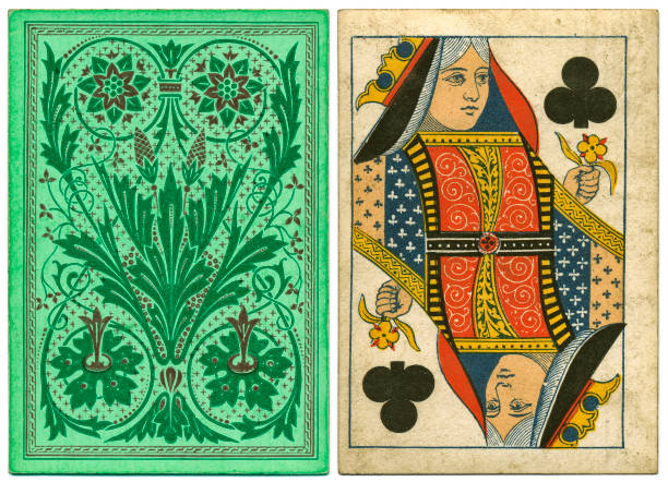 Antique Victorian 19th century playing card front and floral back design Antique 19th century Queen of Clubs with a green floral back design. The back design seems to represent a stylised anemone plant, a flower that has seven petals. The queen of clubs has a pink face, a characteristic sometimes associated with the de la Rue card factory in the 1870 to 190 period. whiteway stock pictures, royalty-free photos & images