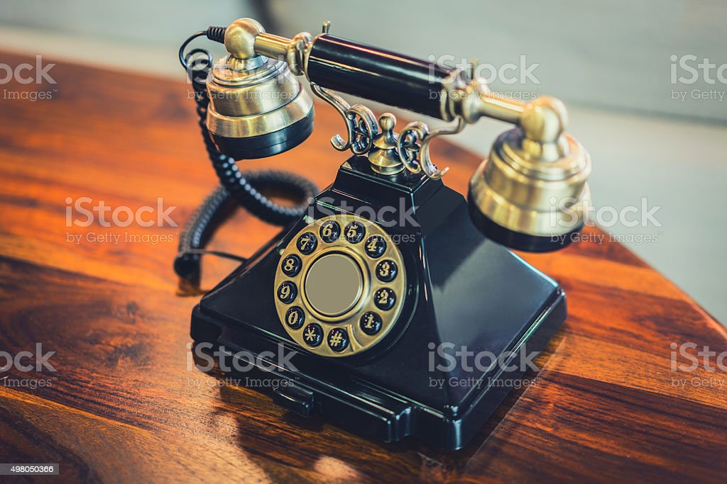 Antique Victorian-Style Rotary Telephone Sitting on Table stock photo