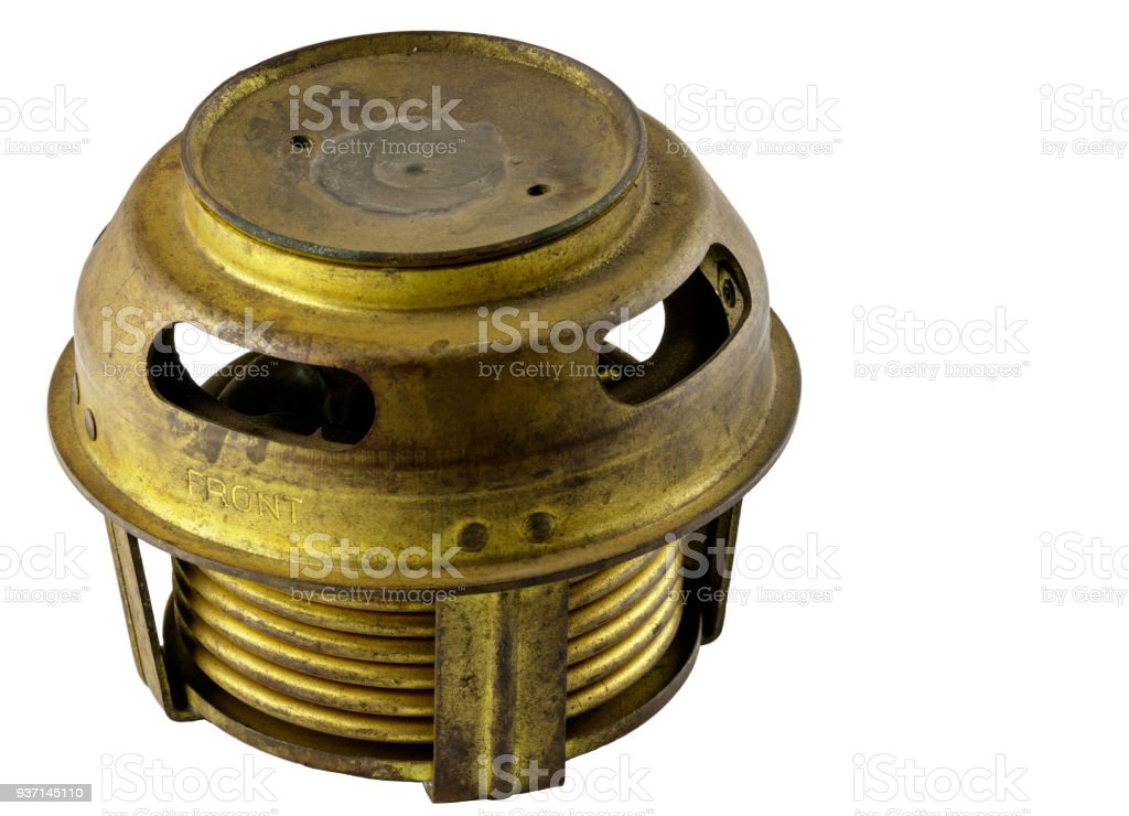 Antique vintage american automobile brass bellows style thermostat assembly on a white background stock photo