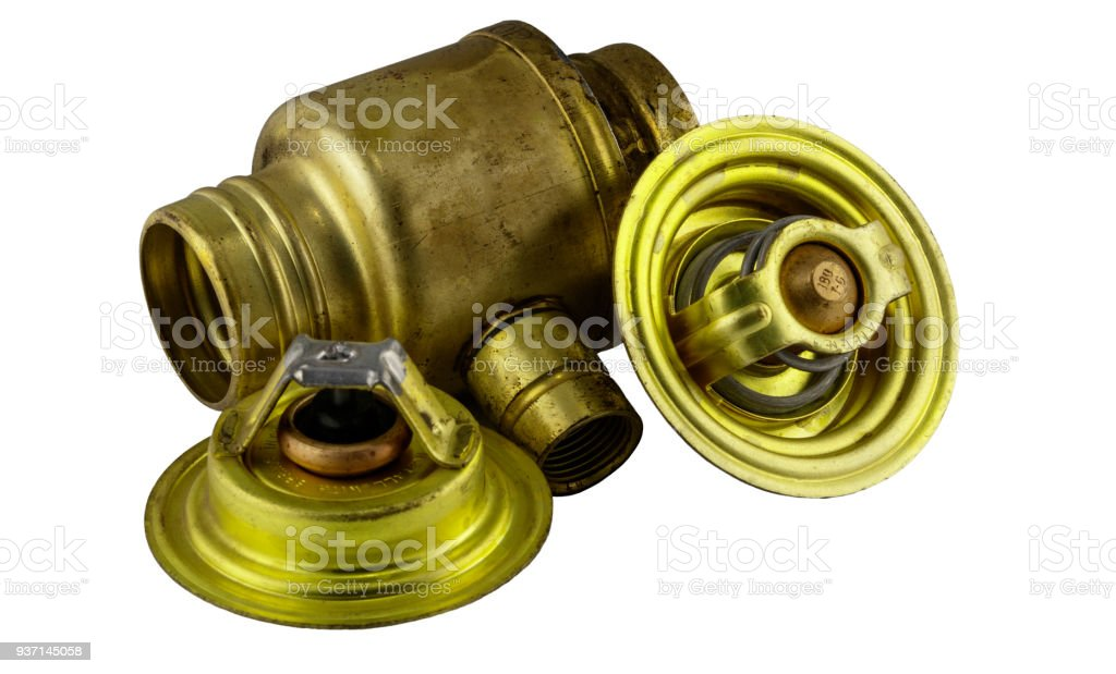 Antique vintage american automobile brass thermostat assemblies on a white background. stock photo