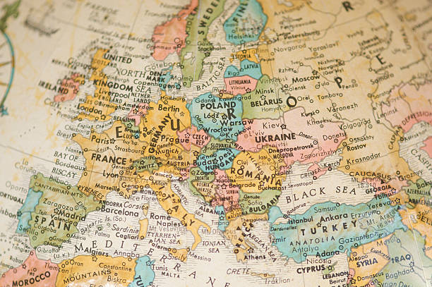 antique vintage map of europe selective focus sepia - europe map stock photos and pictures