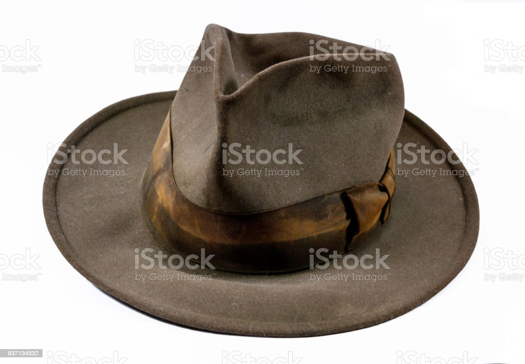 Antique vintage old worn out stained felt hat stock photo