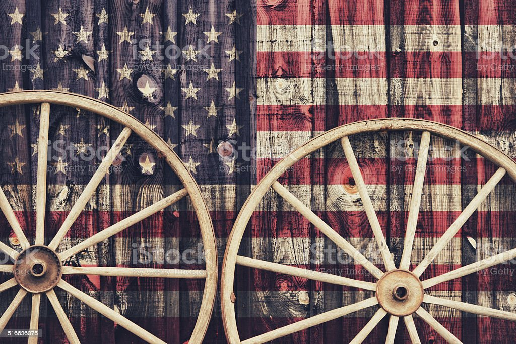 Antique Wagon Wheels with USA flag stock photo