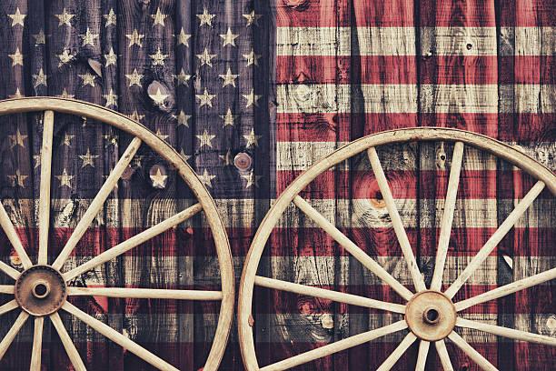 Antique Wagon Wheels with USA flag stock photo