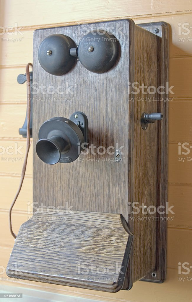 Antique wall telephone stock photo