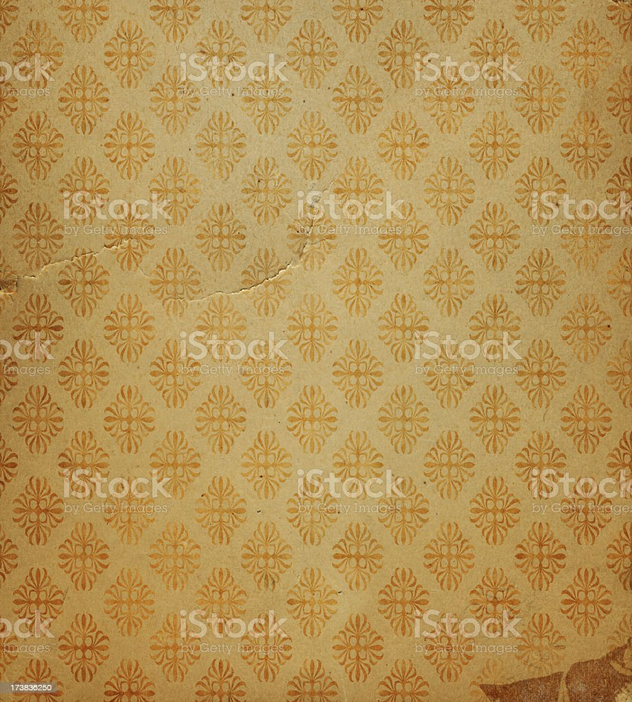 antique wallpaper with gold flake stock photo
