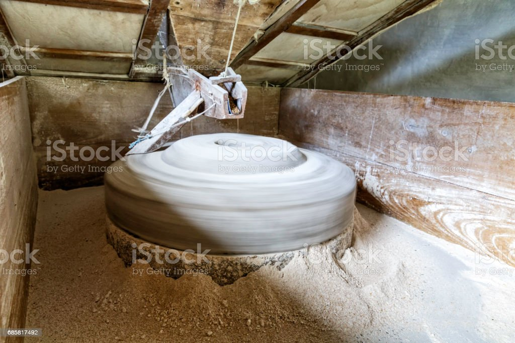 Antique water powered wheat mill grinding flour stock photo