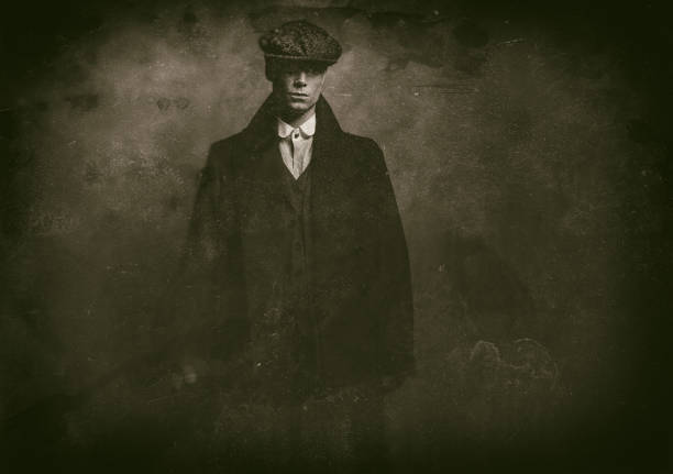 Antique wet plate photo of mysterious 1920s english gangster with flat cap and black coat. Antique wet plate photo of mysterious 1920s english gangster with flat cap and black coat. gangster stock pictures, royalty-free photos & images
