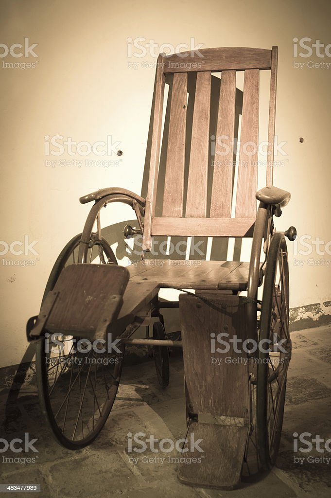 Antique Wheelchair stock photo
