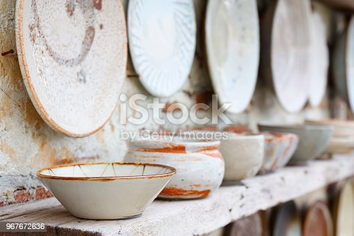 istock antique white and color cup jar dish and bowl vintage and retro on the old wood shelf and white brick wall for home and restaurant interior or exterior architecture decor background 967672636