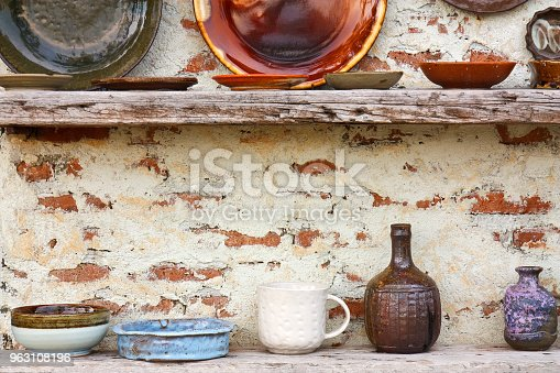 istock antique white and color cup jar flowerpot dish and bowl vintage and retro on the old wood shelf and white brick wall for home and restaurant interior or exterior architecture decor background 963108196