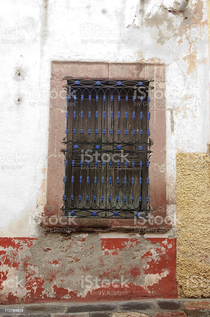 Antique window in weathered wall royalty-free stock photo