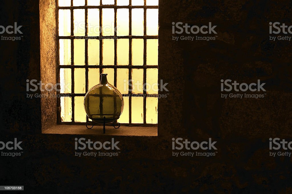 Antique Wine Decanter in a Cellar window royalty-free stock photo