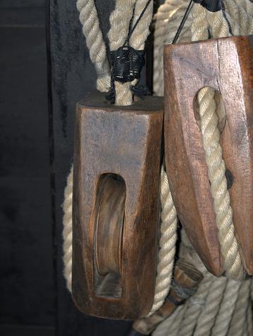 501889762 istock photo antique wood sailboat rigging 519974541