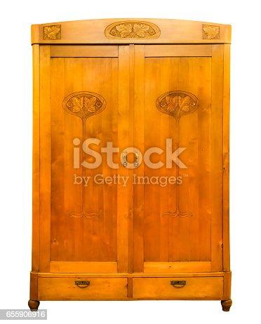 istock Antique wood wardrobe isolated on white 655906916