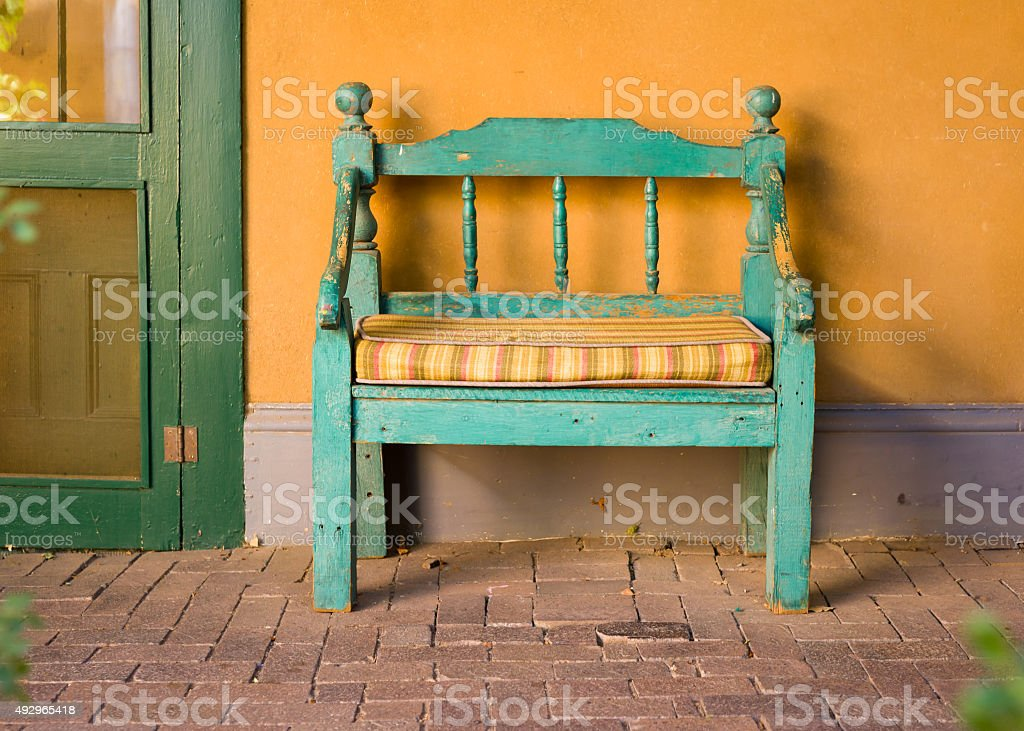 Antique Wooden Bench in Santa Fe stock photo