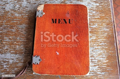 914465180 istock photo Antique wooden cafe menu 929835326