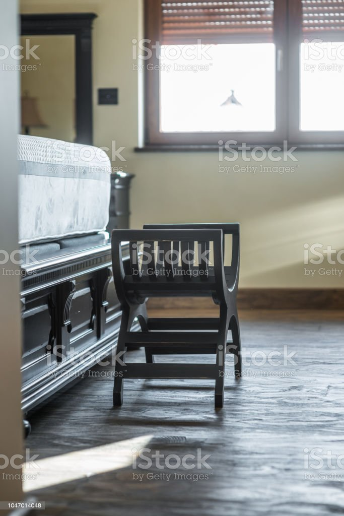 Pleasant Antique Wooden Foot Stool Next To Bed In Interior Stock Dailytribune Chair Design For Home Dailytribuneorg
