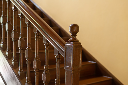 antique wooden handrail and staircase, balusters. selected focus on handrail