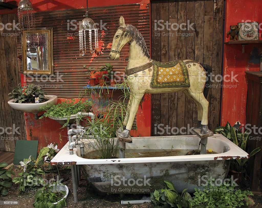 Antique wooden horse set in old bathtub royalty-free stock photo