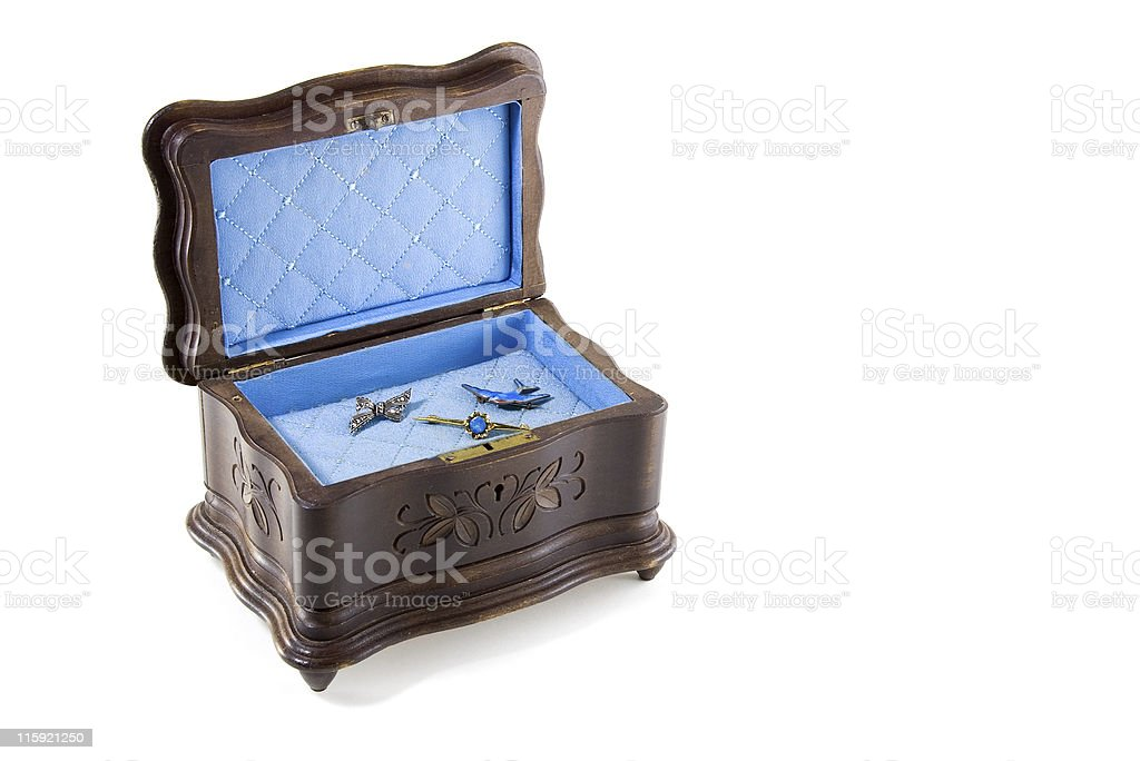 Antique wooden musical jewellery box containing brooches stock photo