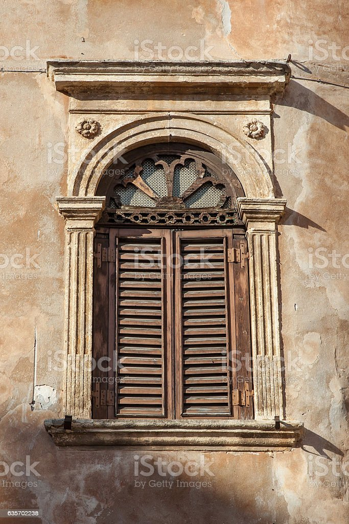 antique wooden shutters window in old stone house royalty-free stock photo