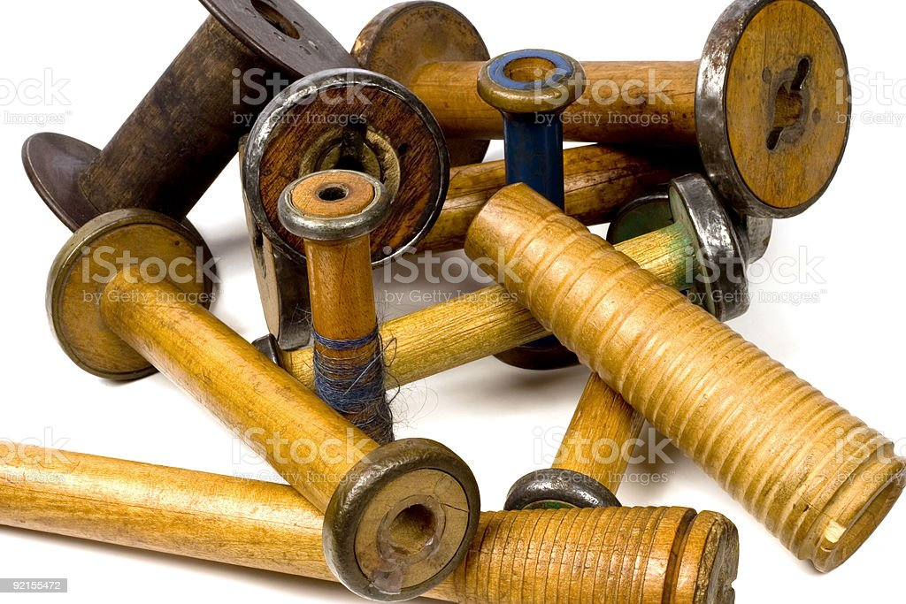 antique wooden spools stock photo