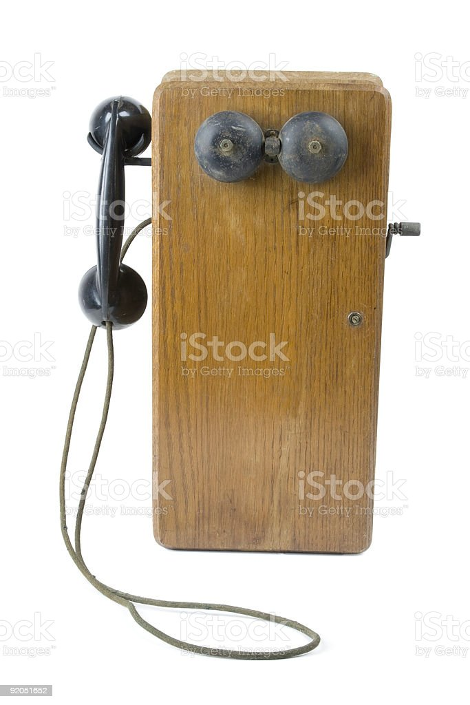 Antique Wooden Telephone on White Background stock photo