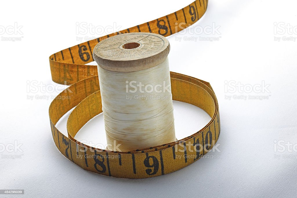 Antique Wooden Thread Spools and Measuring Tape stock photo