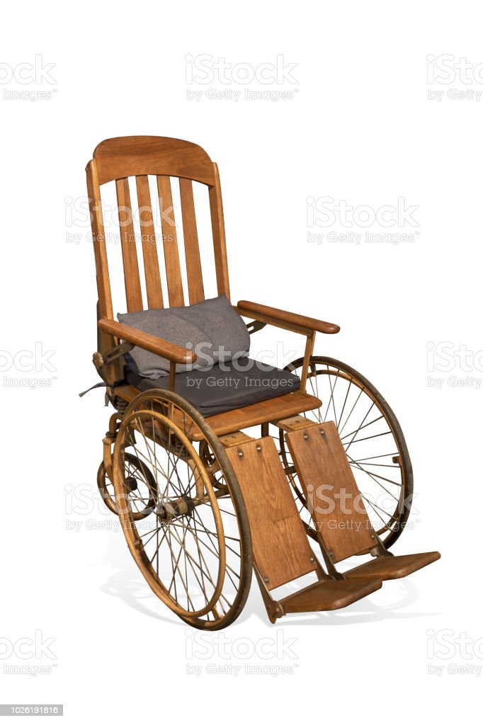 Antique wooden wheelchair isolated on white background with clipping path stock photo