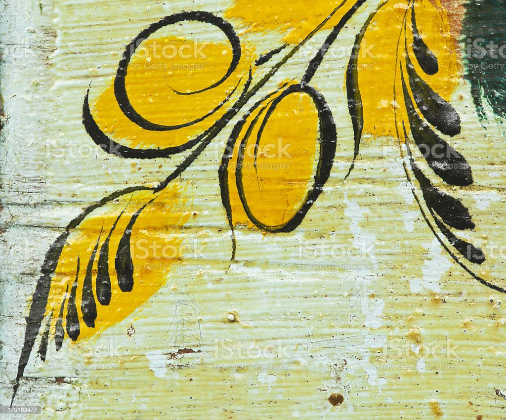 Antique yellow painted ornate flower motive. royalty-free stock photo