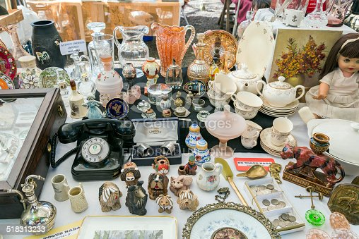 Rosario, Argentina - October 12, 2014: A mixture of antiques from a telephone to dishware on sale at the Retro Fair