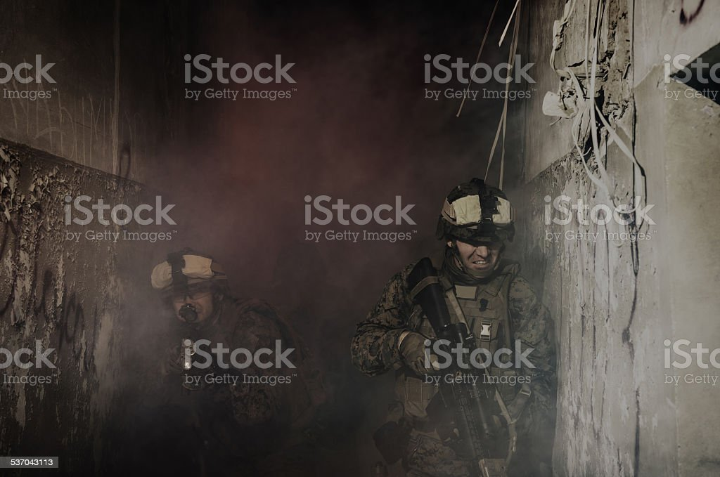 Anti-terrorist operation. Soldiers going up in smoke stock photo