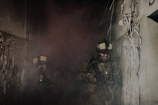Anti-terrorist operation. Soldiers going up in smoke Destroyed object. antiterrorist stock pictures, royalty-free photos & images