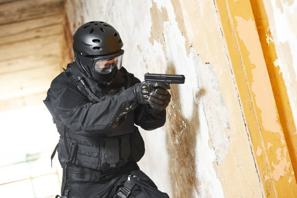 Anti-terrorist police soldier armed with pistol ready to attack Military industry. Special forces or anti-terrorist police soldier armed with pistol ready to attack during clean-up operation, mission antiterrorist stock pictures, royalty-free photos & images